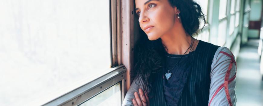 Depressed Woman Looking Outside Train Window