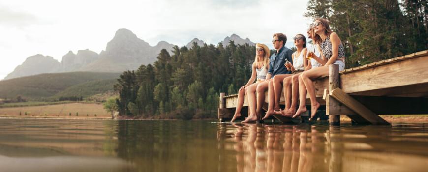 Five Friends Enjoying View from Lake