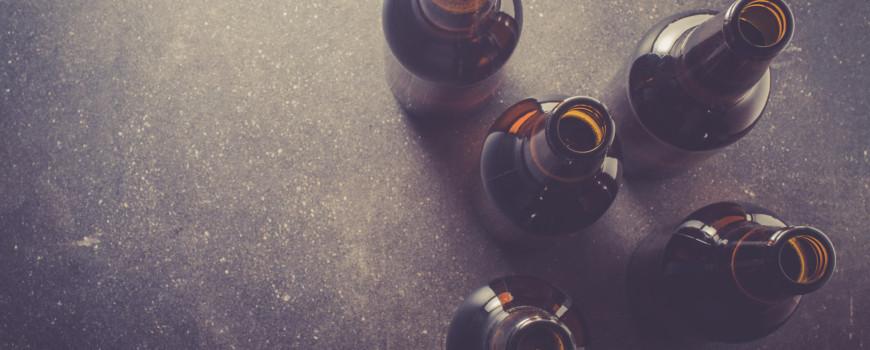Five Beer Bottles on Black Background