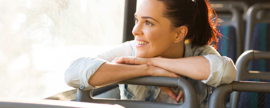 female commuter daydreaming on bus
