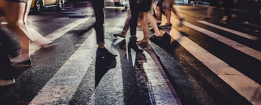 people crossing the sidewalk