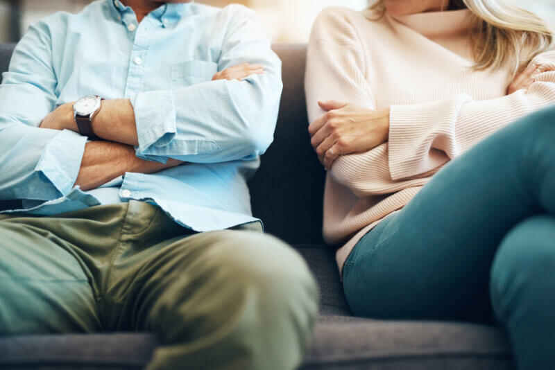 Co-parents sitting side-by-side during mediation