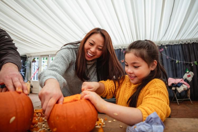 Mother Daughter Carving Pumpkins