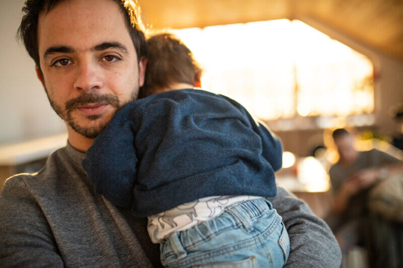 Single dad holding infant son
