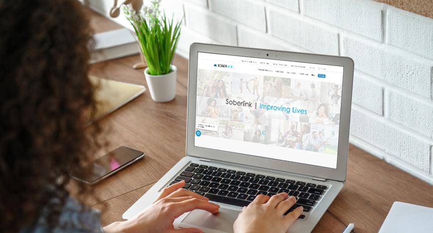 Woman logging on to Soberlink website