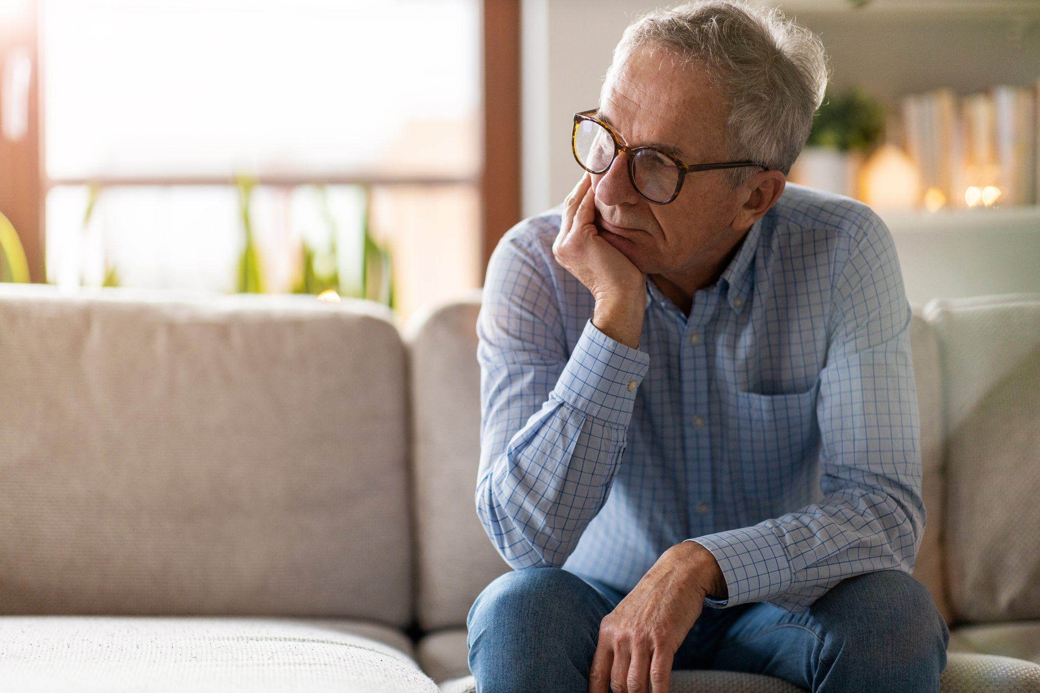 older man sitting on his couch.