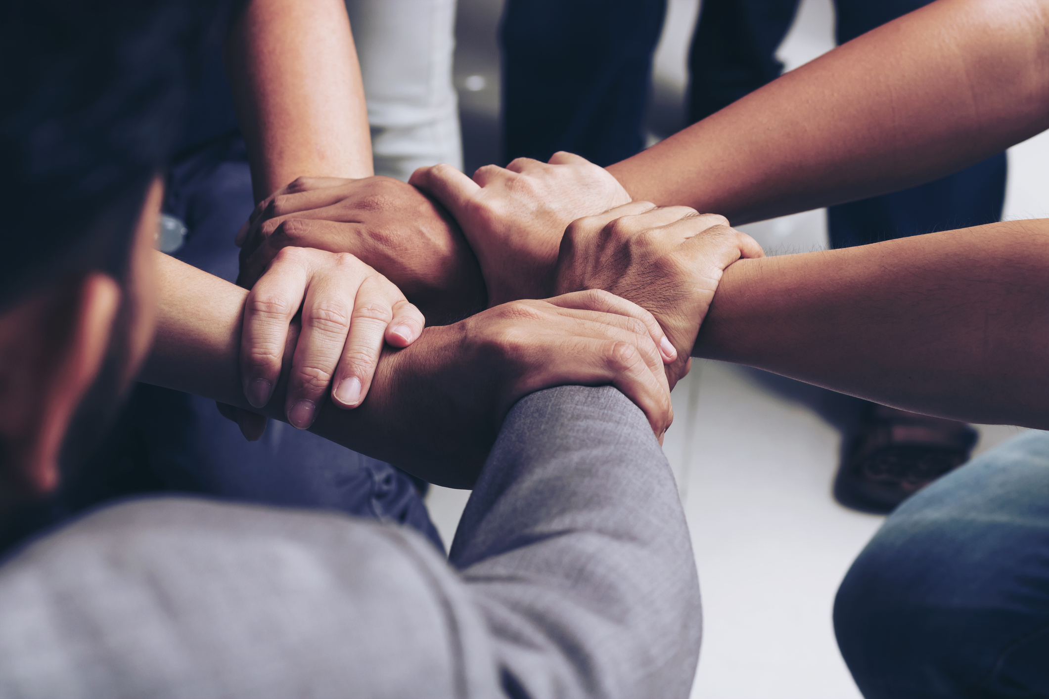 People of different races linking hands