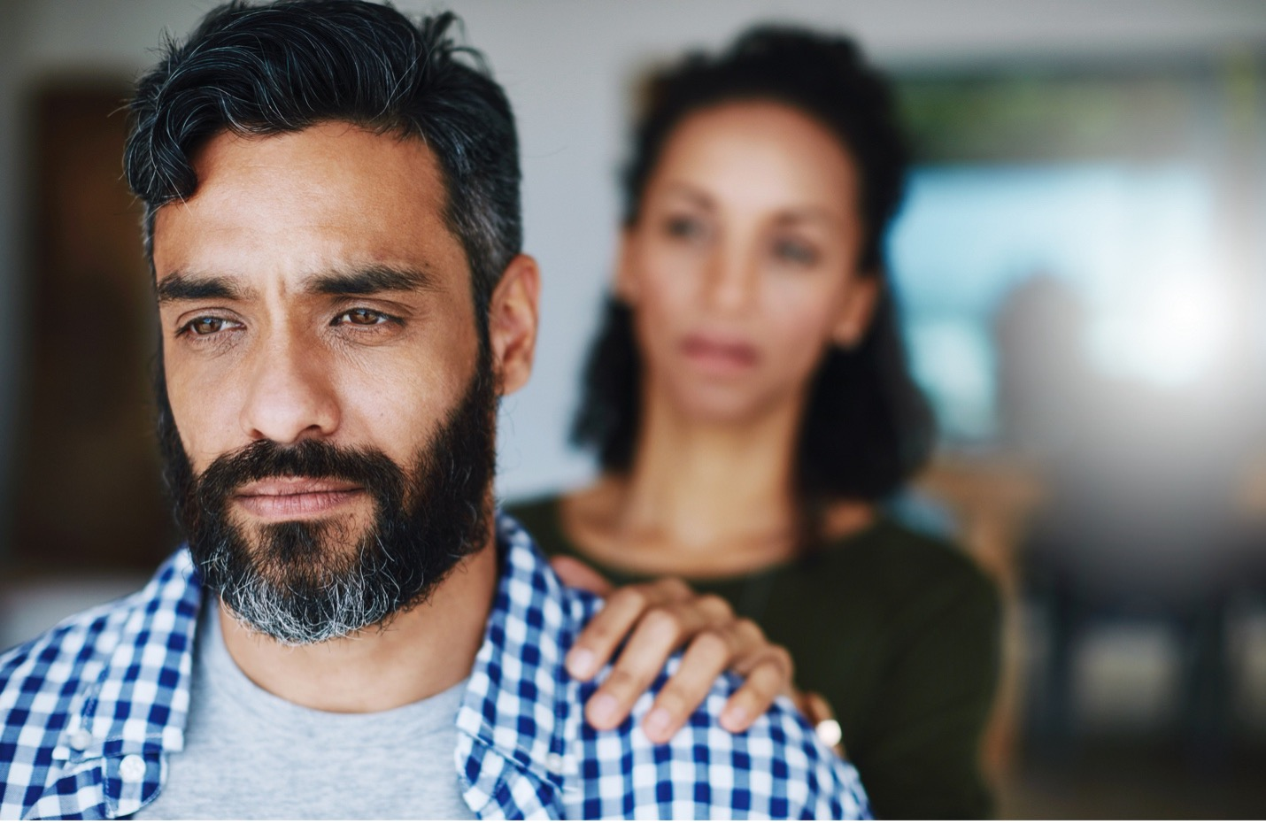 Man getting comfort from a women