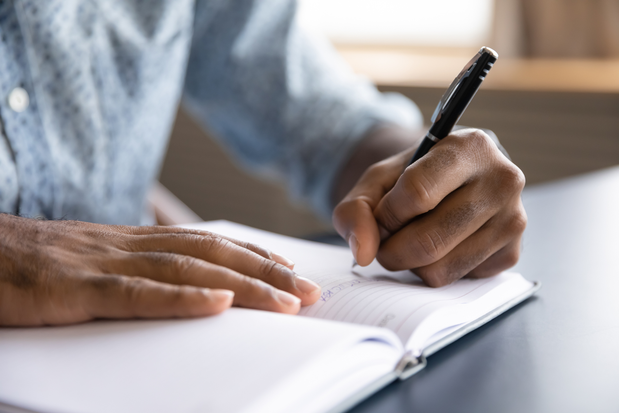 Man writing down his accountability and recovery goals