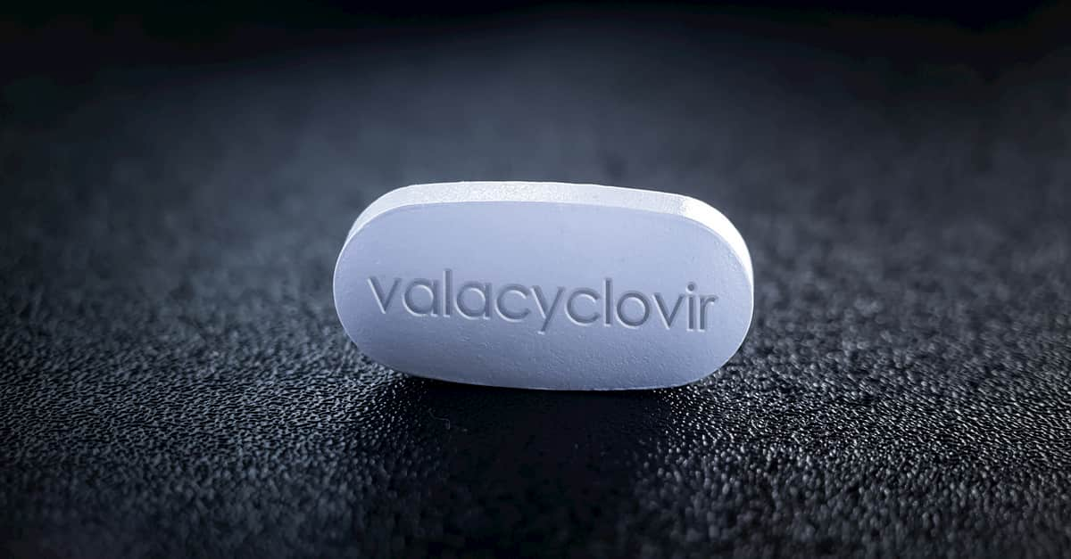 Valaciclovir pill of antiviral medication used to treat outbreaks of herpes simplex and herpes zoster shingles