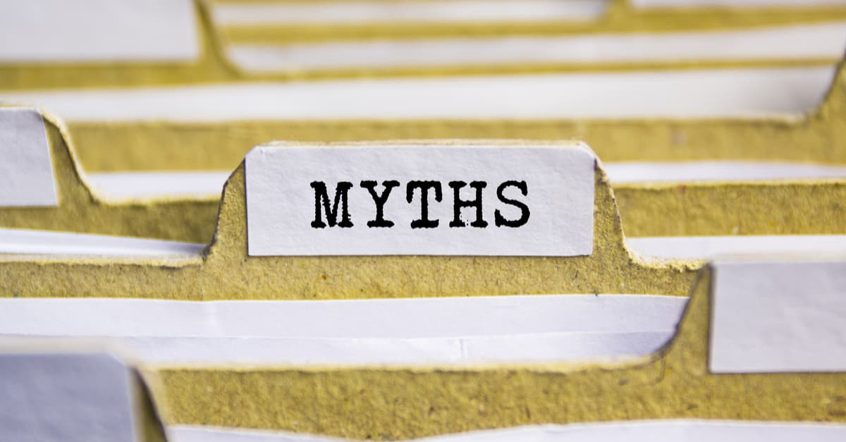 The word myths on an index card in a paper in filing system