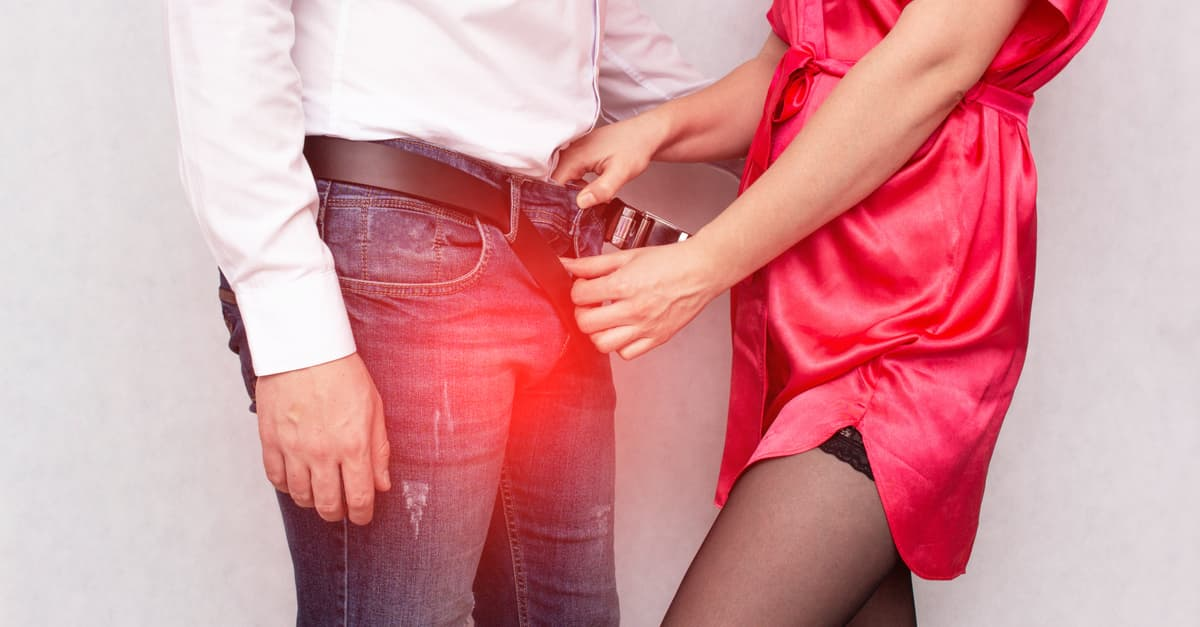 A girl unbuttons her pants in a contagious male sexually transmitted infection