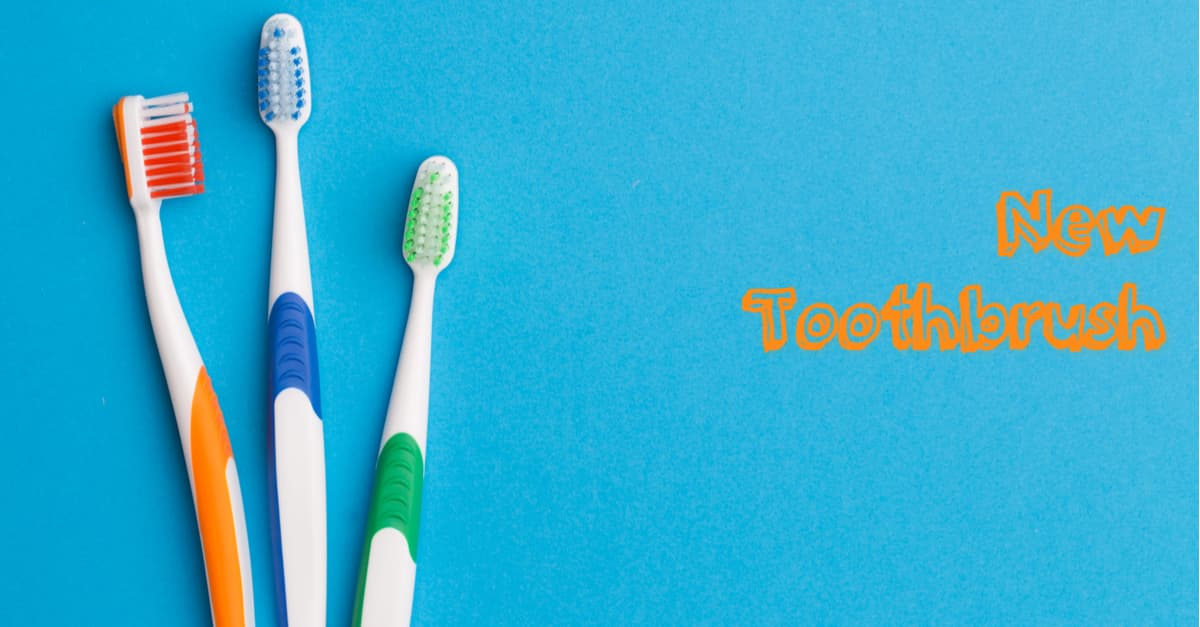 New toothbrush with 3 toothbrushes on blue background