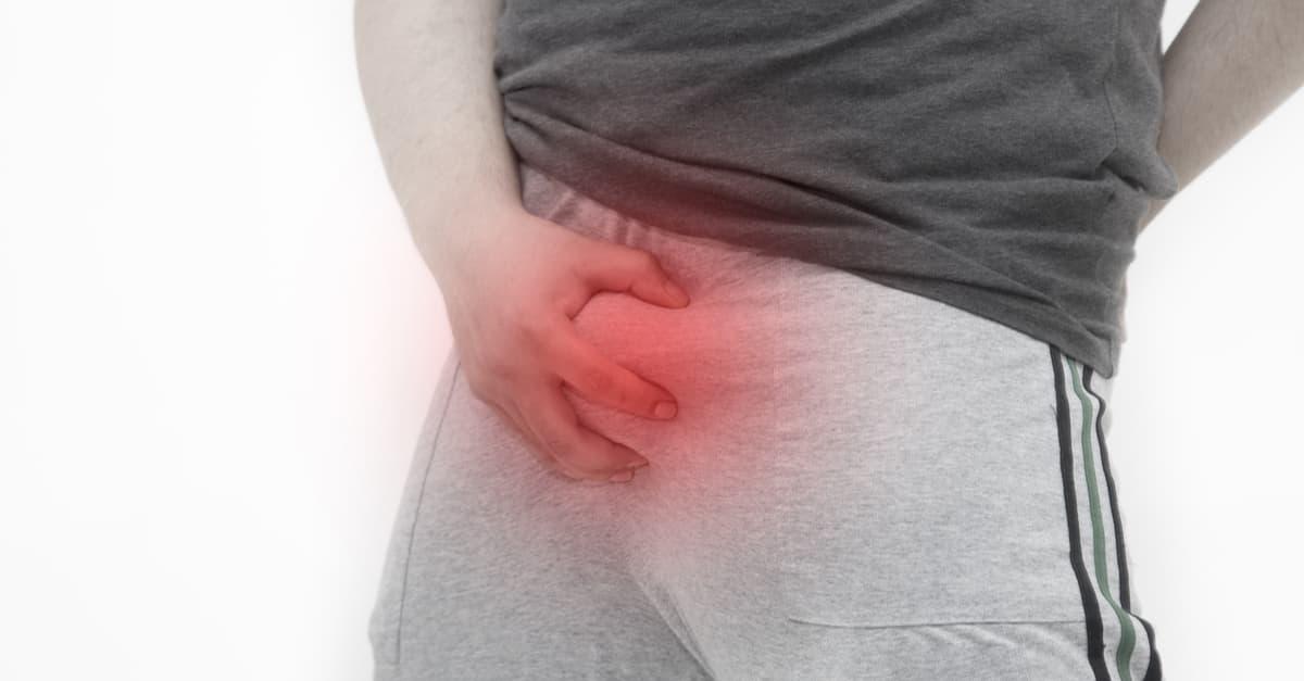 Genital herpes in men - man suffering inflammation