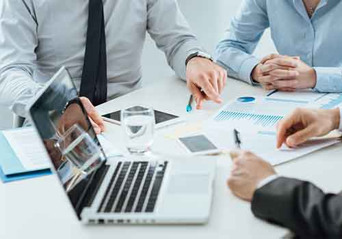 Business Lawyers at a meeting with laptop