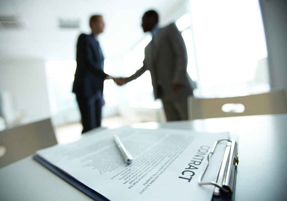 Business contract attorneys shaking hands