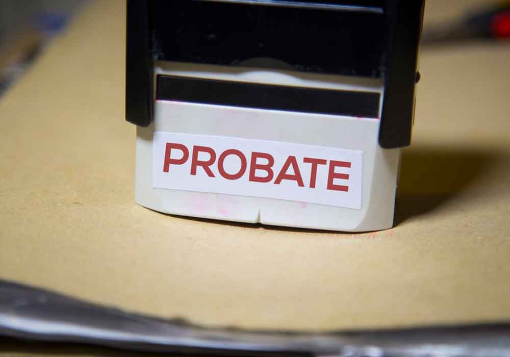 Probate stamp on a big folder of paperwork at office of estate planning lawyer