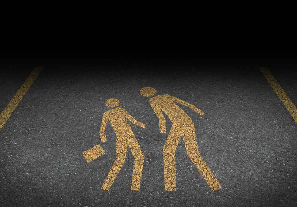 Image of two 2D figures having an argument painted on an asphalt surface