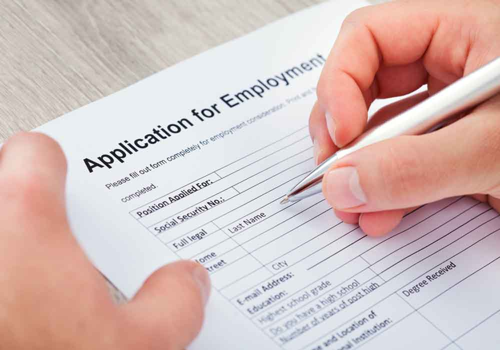 Hand Filling Application to hire an employment contract attorney