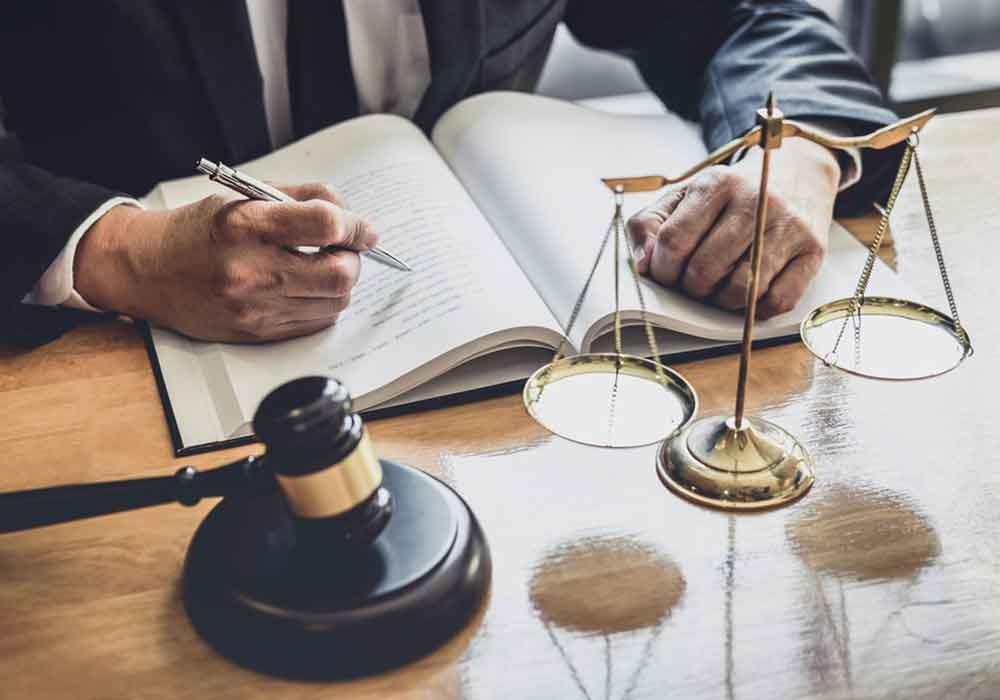 Litigation and Civil Lawyer working with contract papers