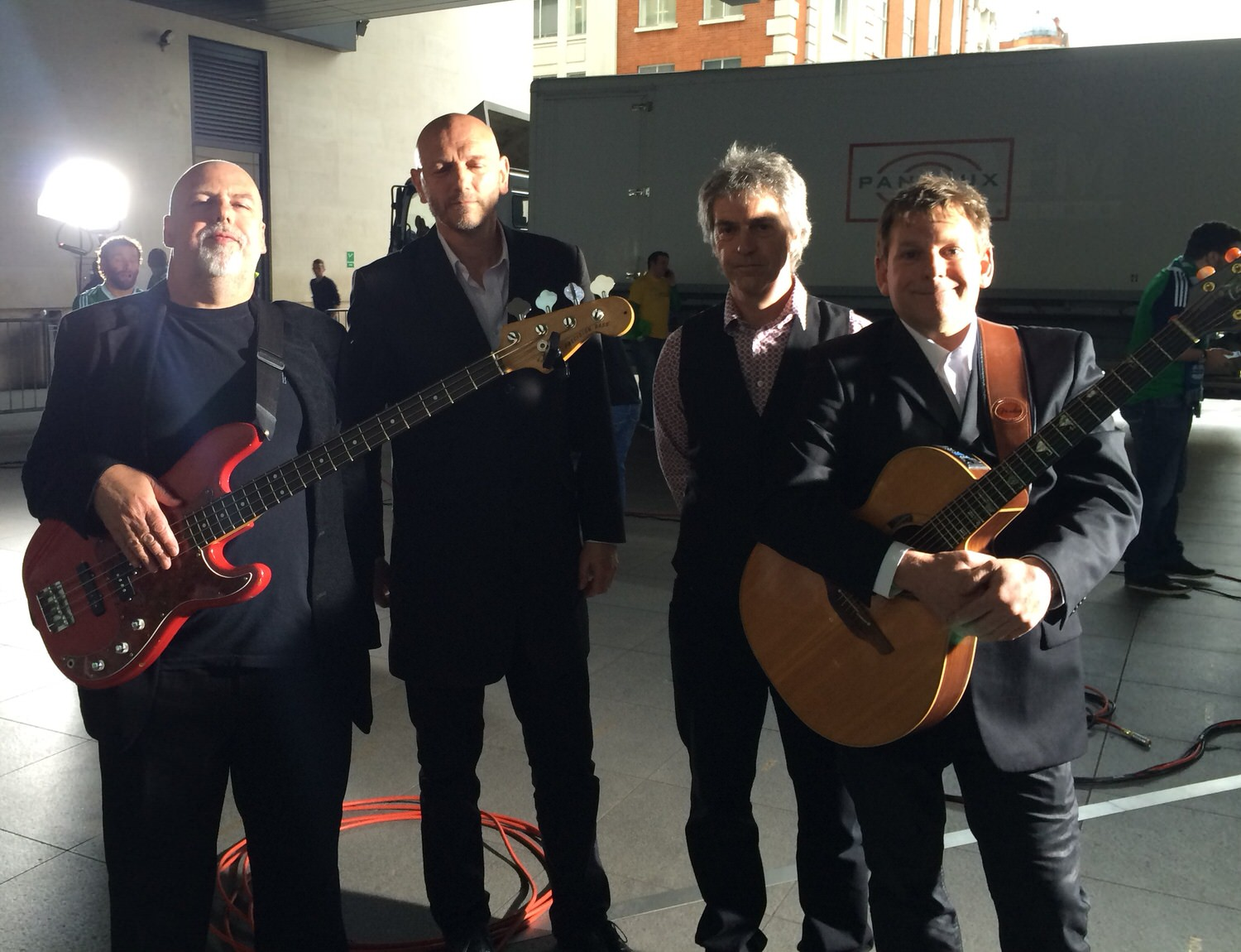 The musicians posing with their instruments