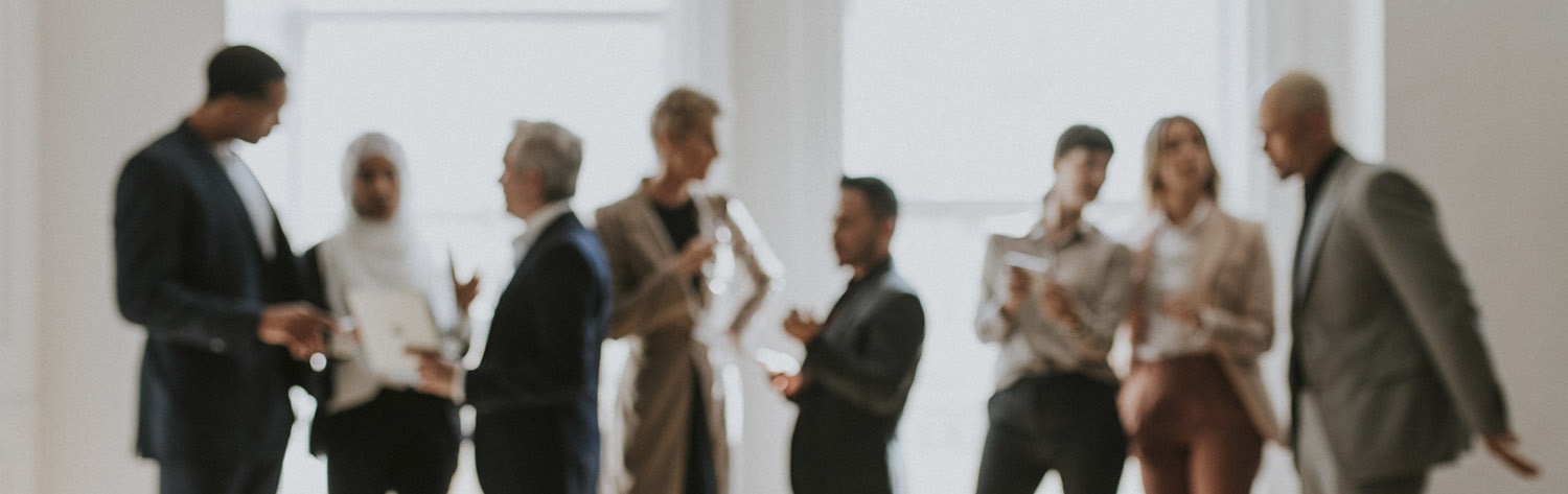 Diverse group of people talking - out of focus