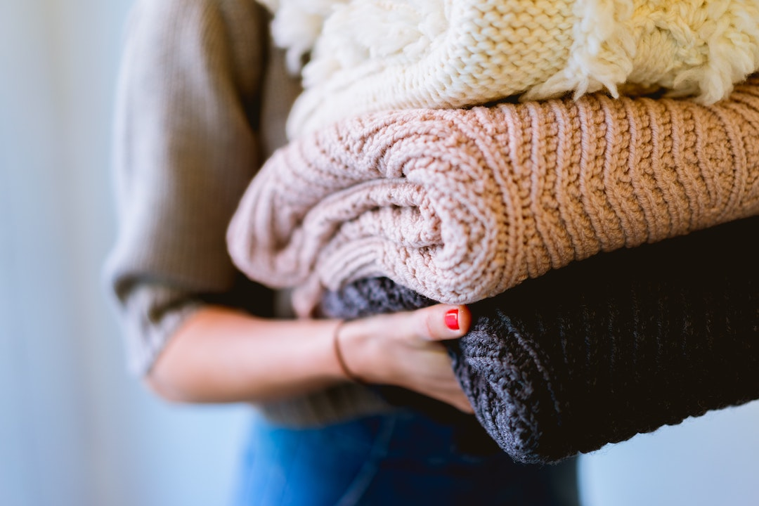 Woman carrying laundry to her new laundry room