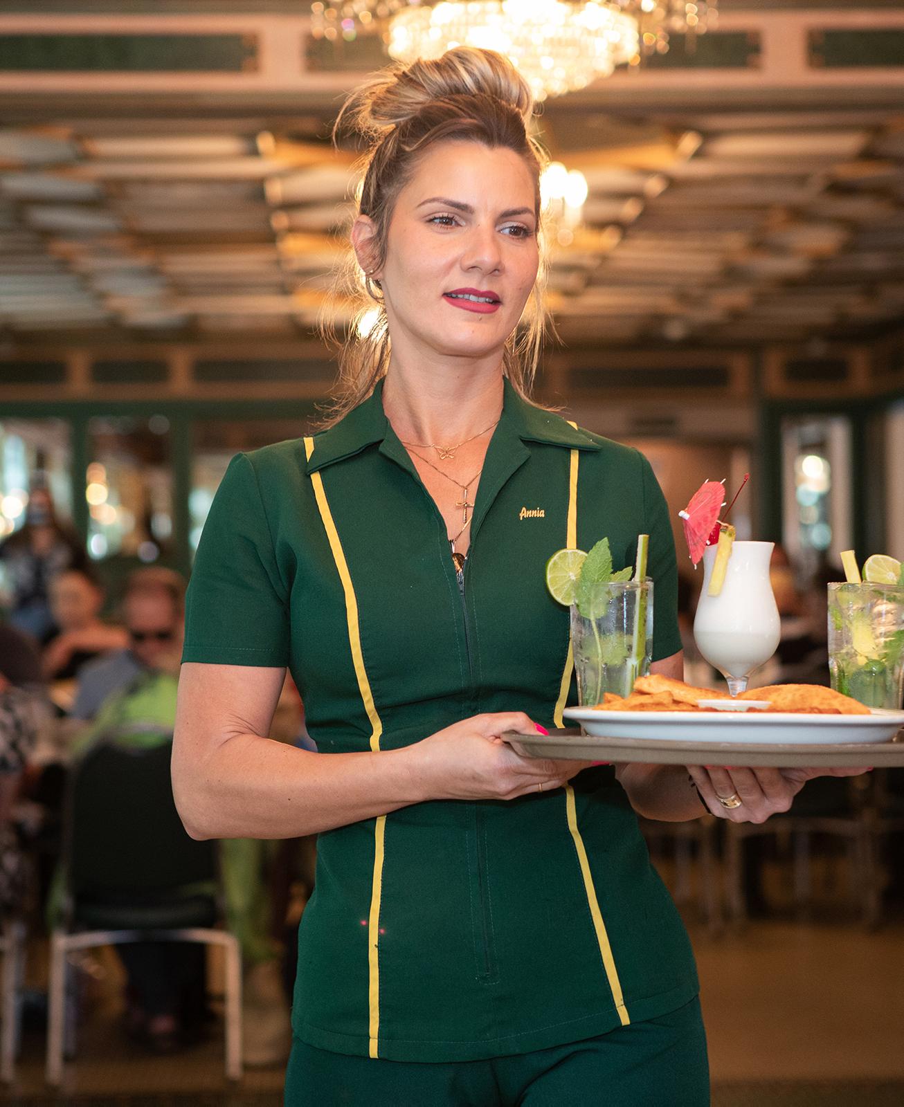Waitress holding drinks