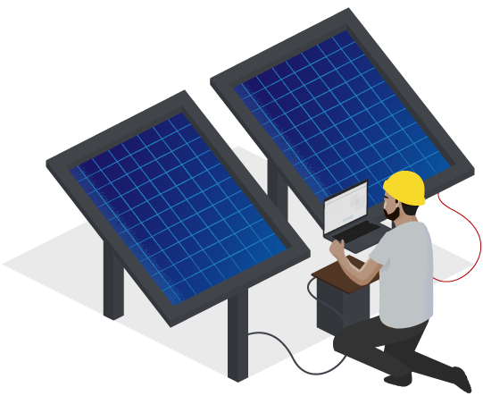 An engineer kneeling down by a set of solar panels wired up to his laptop.