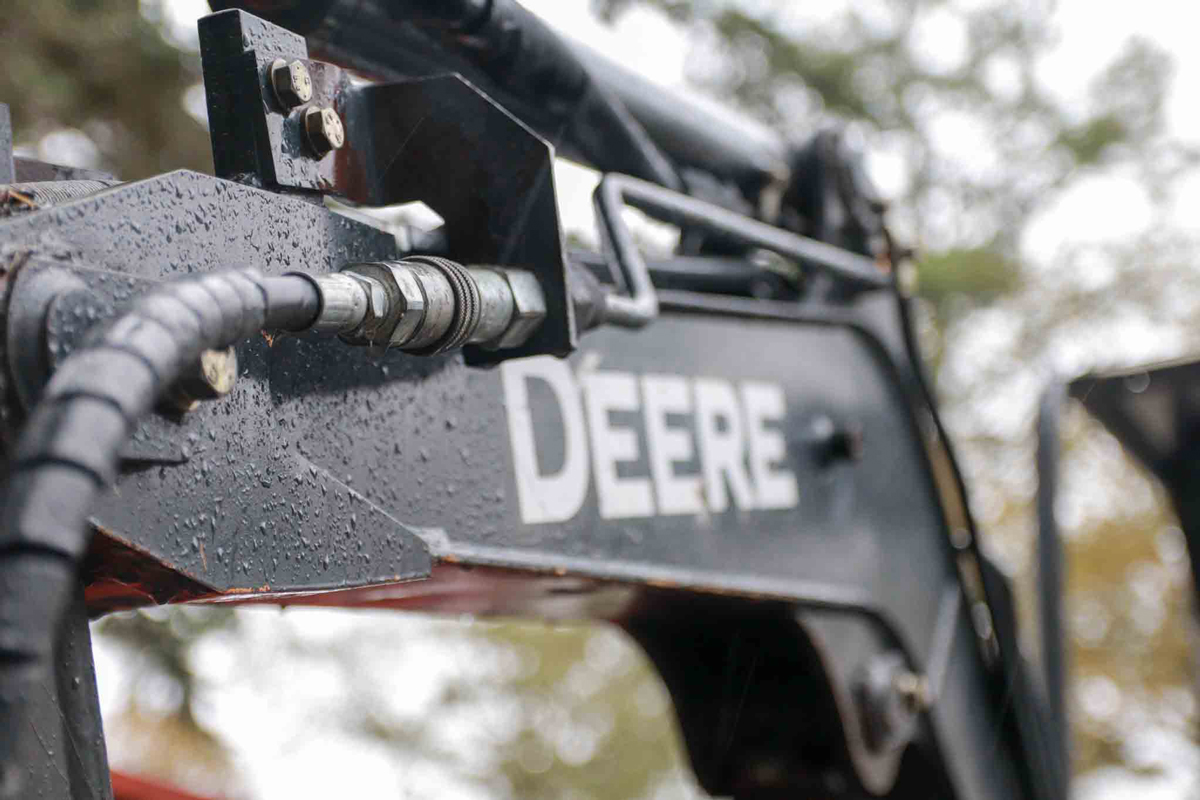 Close up of the John Deer logo on a trench digger.