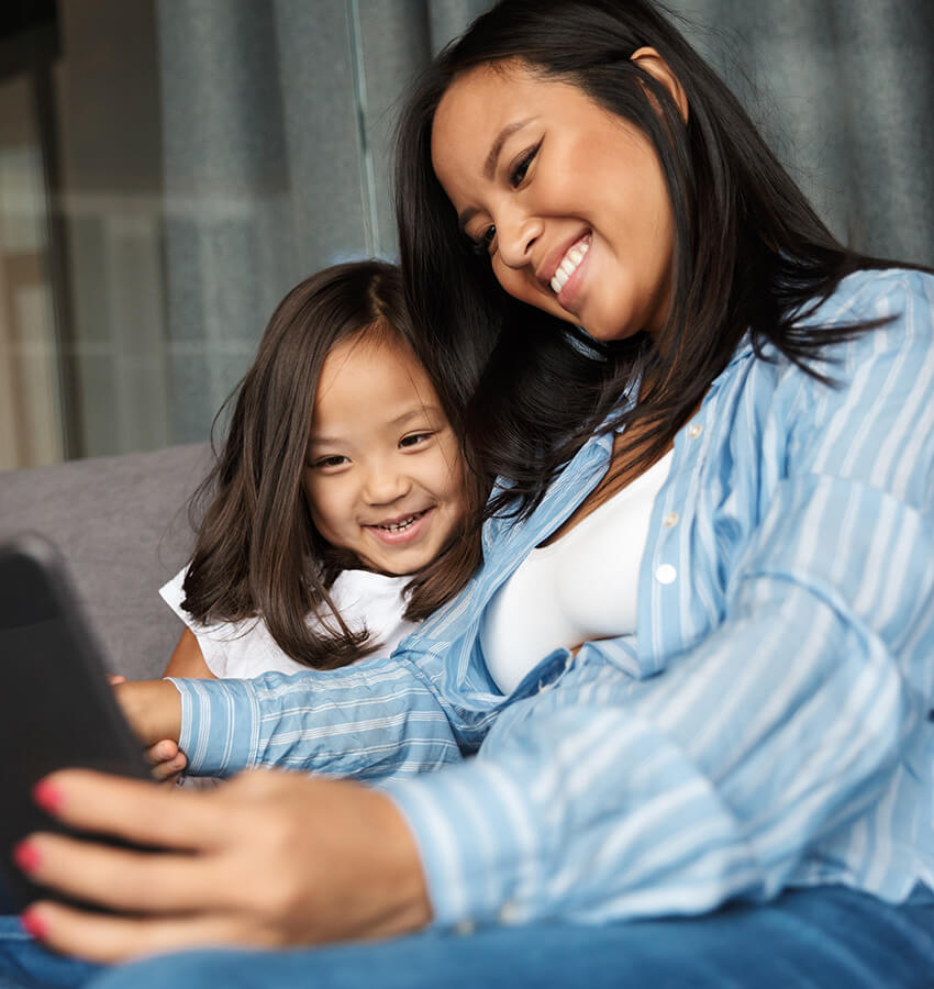 A mother and small child looking at tablet device