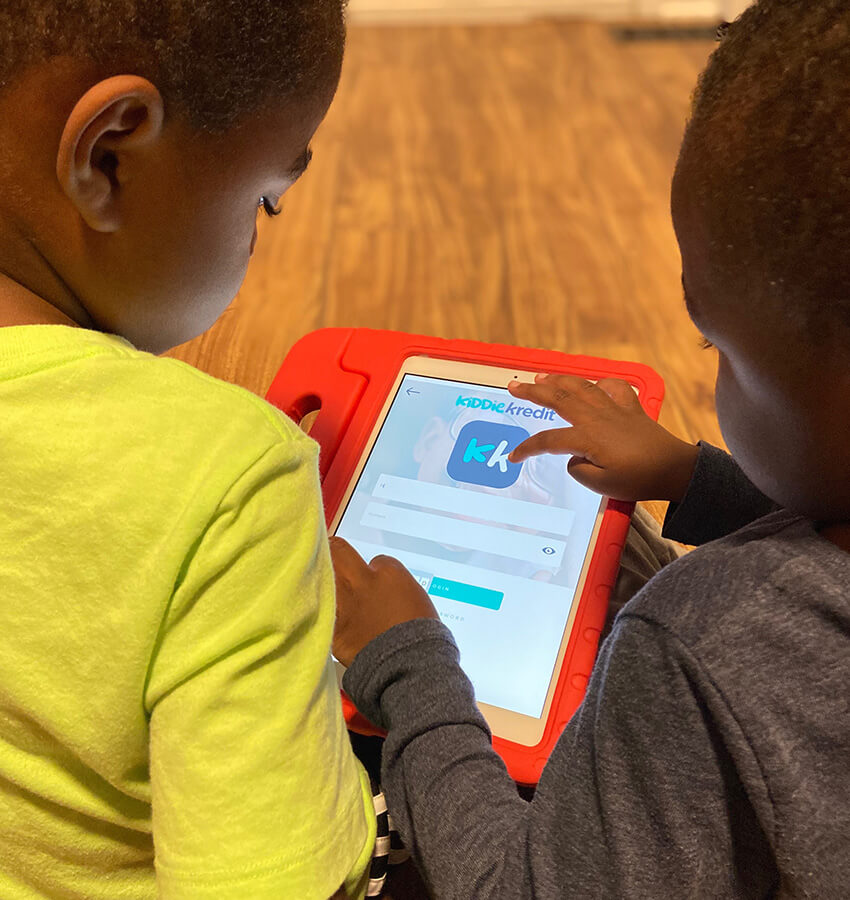 Two small children viewing an app on a tablet device