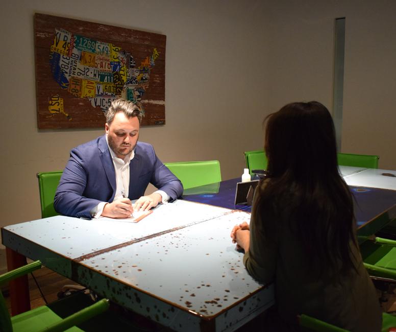 Immigration Attorney Darius Amiri speaking with a client