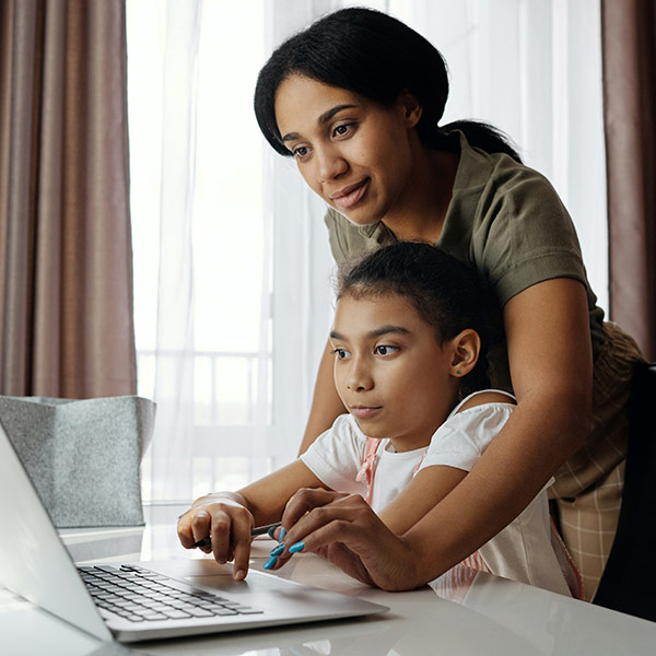 Mom and daughter at home learning with broadband