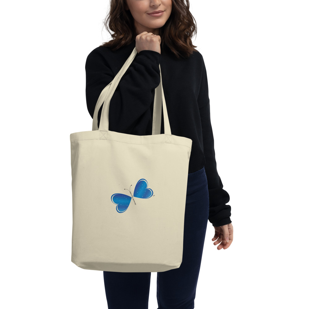 "Say goodbye to plastic and bag your goodies in this organic cotton Be the Change Butterfly tote bag. There's more than enough room for groceries, books, and anything in between.  Features: • 100% certified organic cotton 3/1 twill • Open main compartment • Weight limit: 30lbs (13.6 kg) • 1"" wide dual straps, 24 1/2"" length • Fabric weight: 8 oz/yd² (272 g/m²) • Dimensions: 16"" x 14 ½"" x 5"""