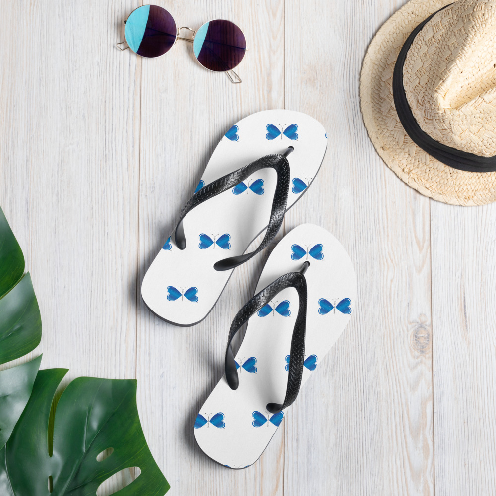 Prepare for an adventurous and carefree summer with a pair of colorful slippers that are created just for you! The rubber sole is lined with a soft fabric to make sure you feel comfortable wherever your day takes you.  • Rubber sole • Customizable 100% polyester fabric lining • Black Y-shaped rubber straps • Toe post style