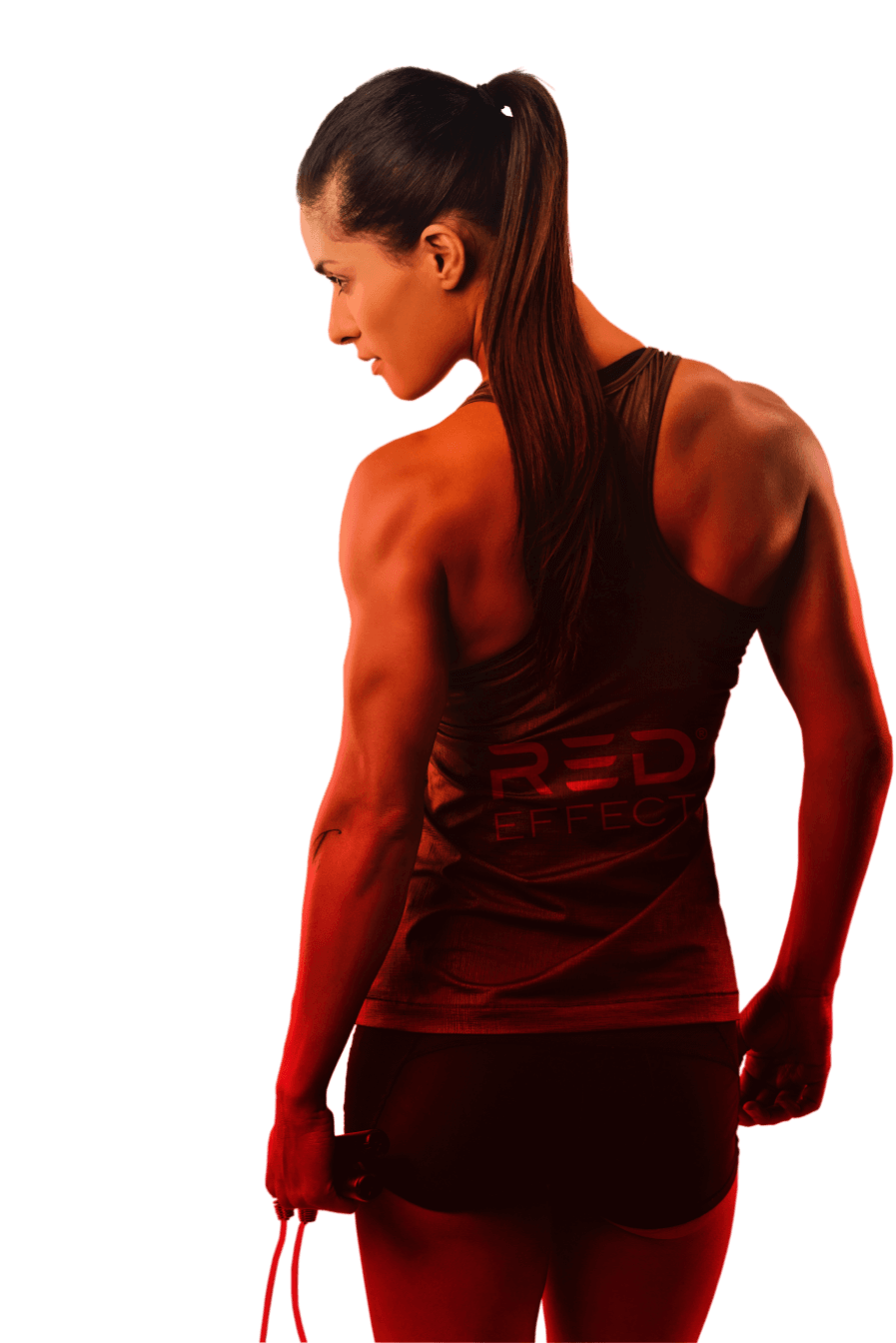 An athletic woman posing to show her muscle definition