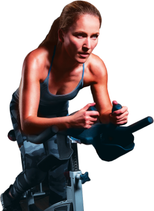 Determines woman riding a stationary bicycle