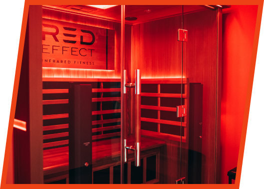 An empty infrared sauna with a glowing red light