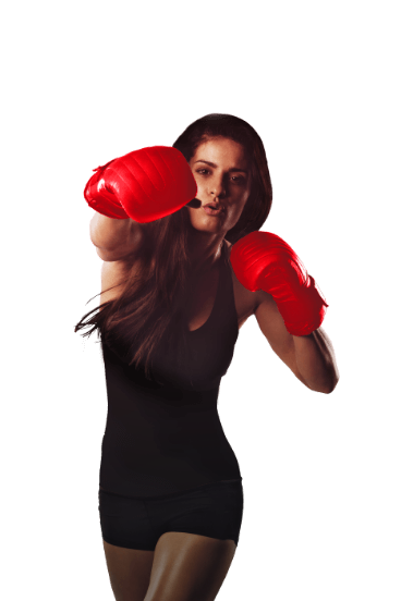 A woman throwing a punch towards the camera