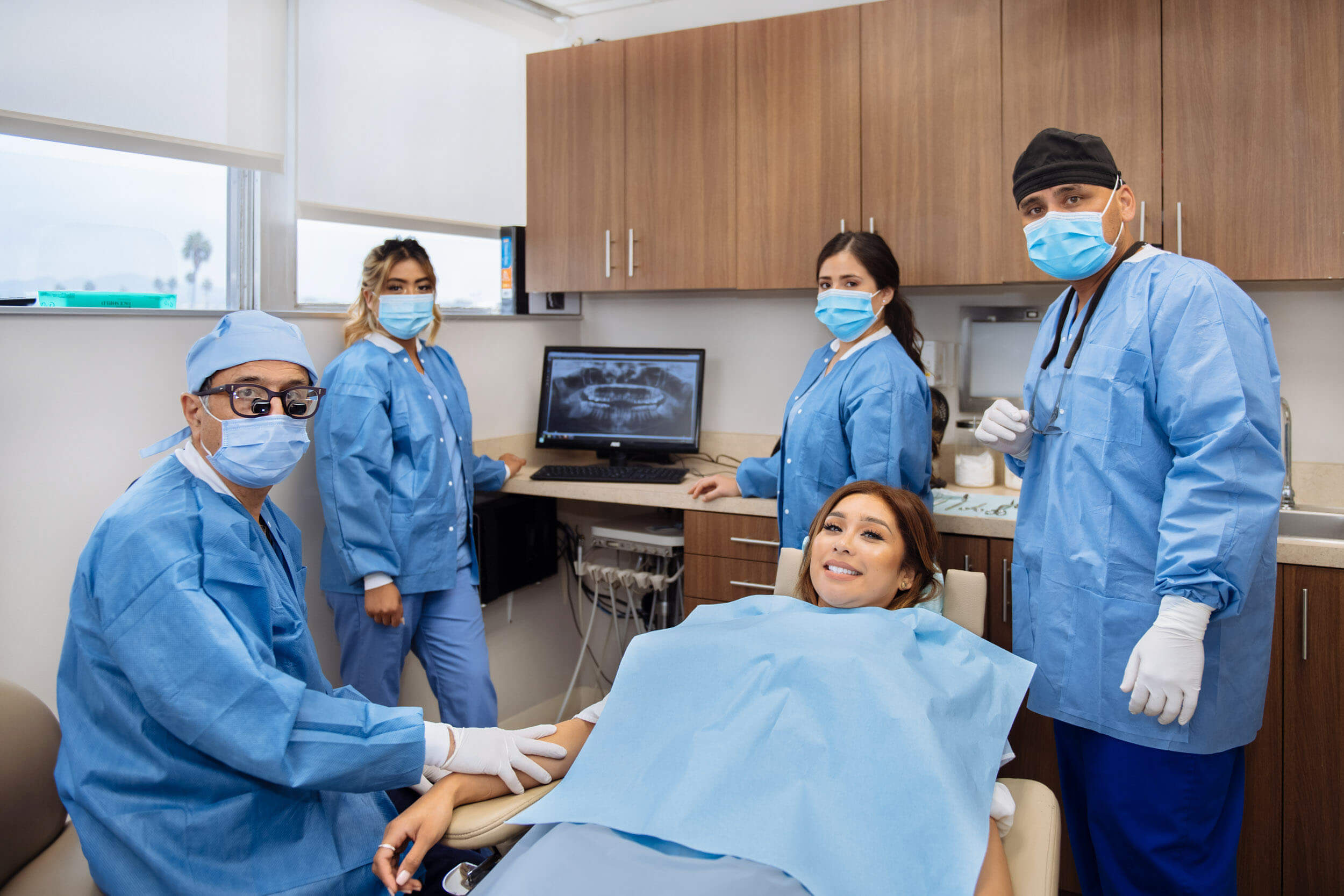 Staff with patient in operating room before surgery