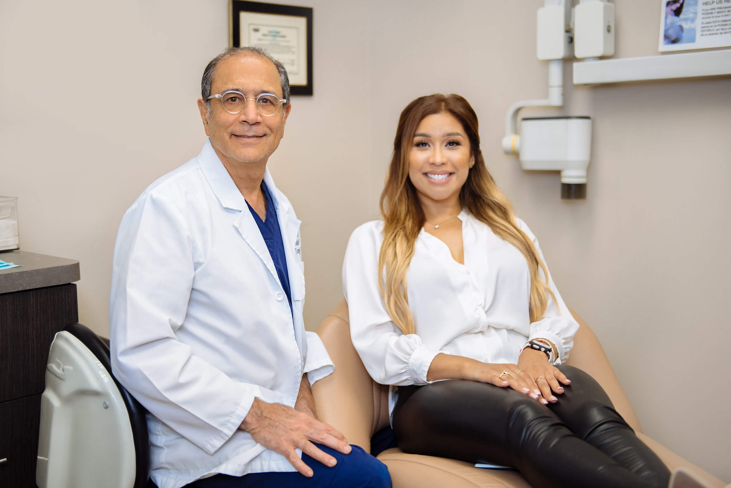 Dr. Shaun Daneshgar sitting with patient