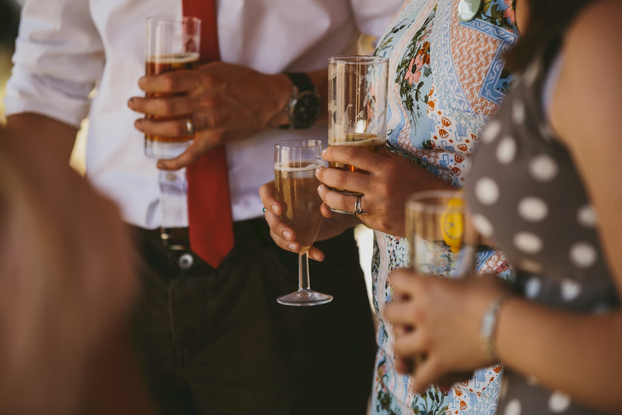 Holding champagne at a wedding