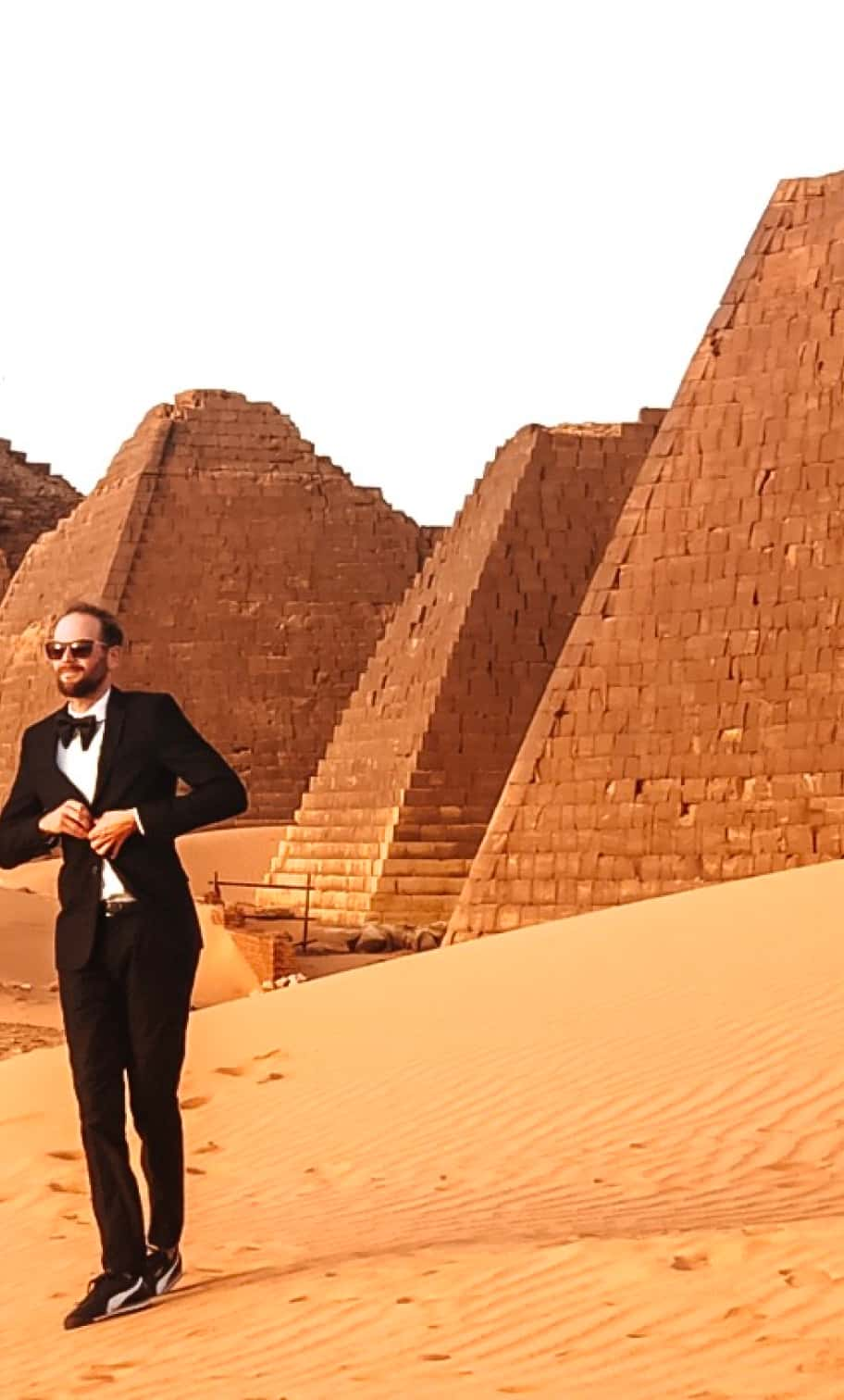 Garrett Gravesen poses in front of the pyramids in Egypt.