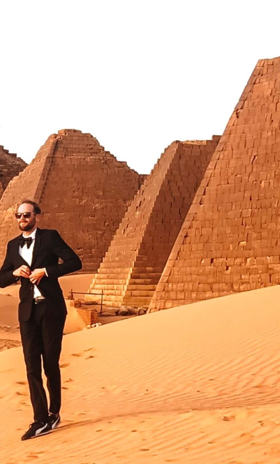 Garrett Gravesen poses in front of the pyramids in Egypt.