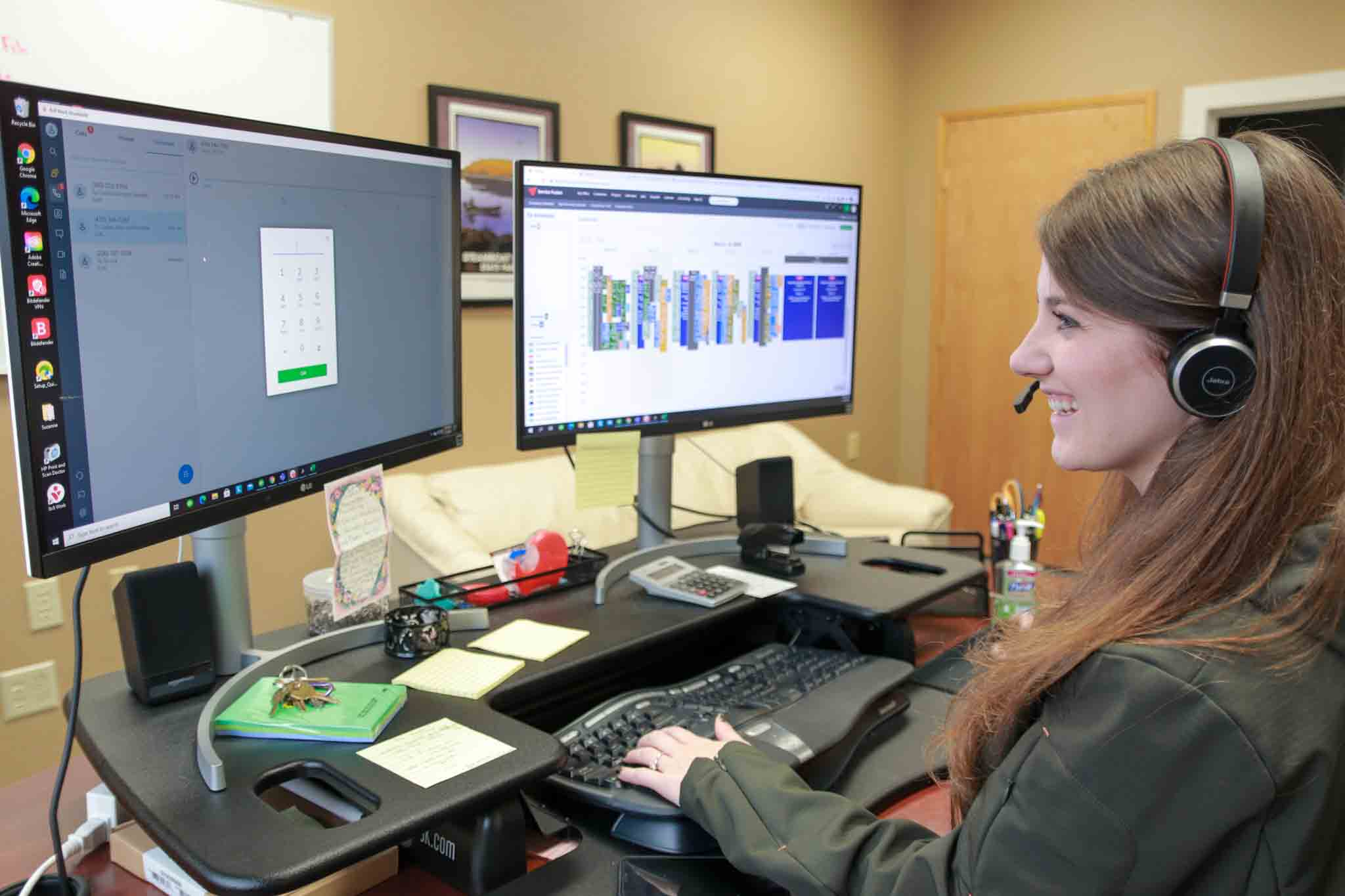 Anacortes Plumbing employee sitting at a computer.