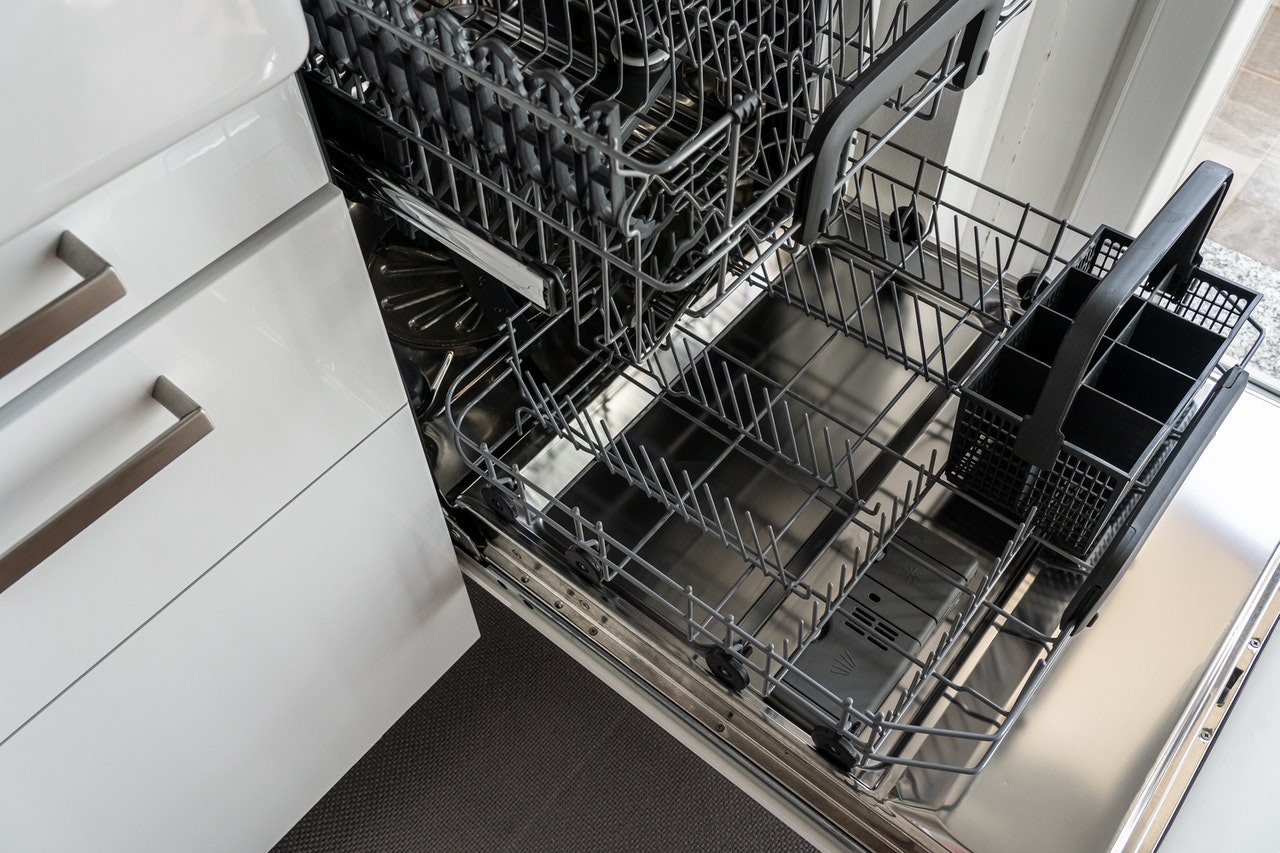An opened dishwasher.