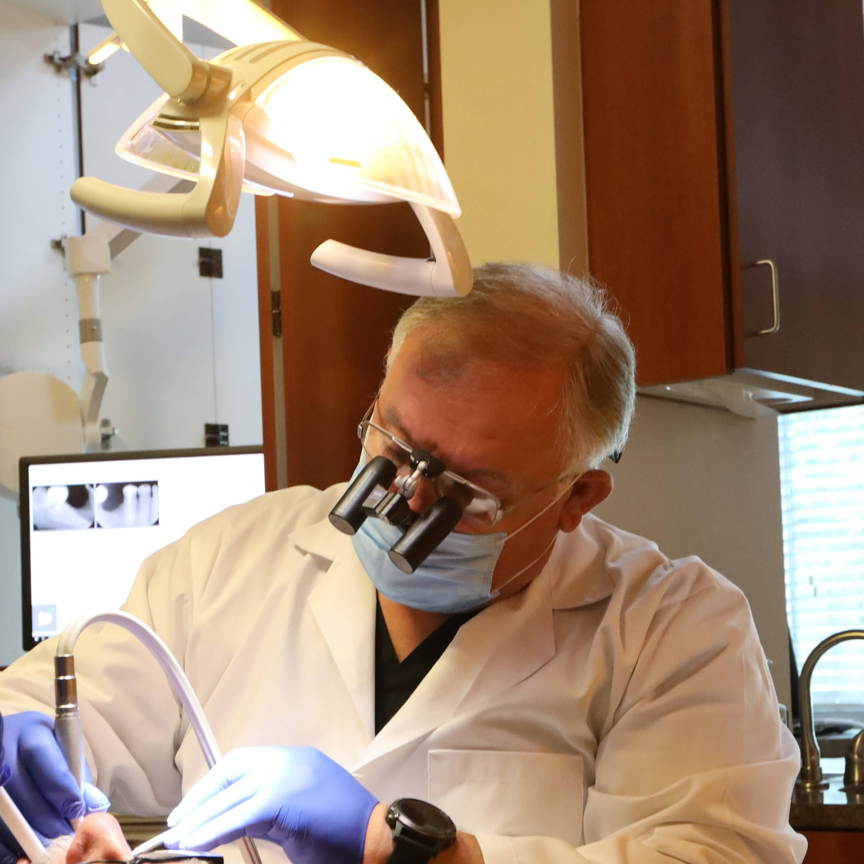 Dr. Lubomir Manov Working On Patient