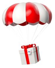 Jouet de Noël livré en parachute blanc et rouge.