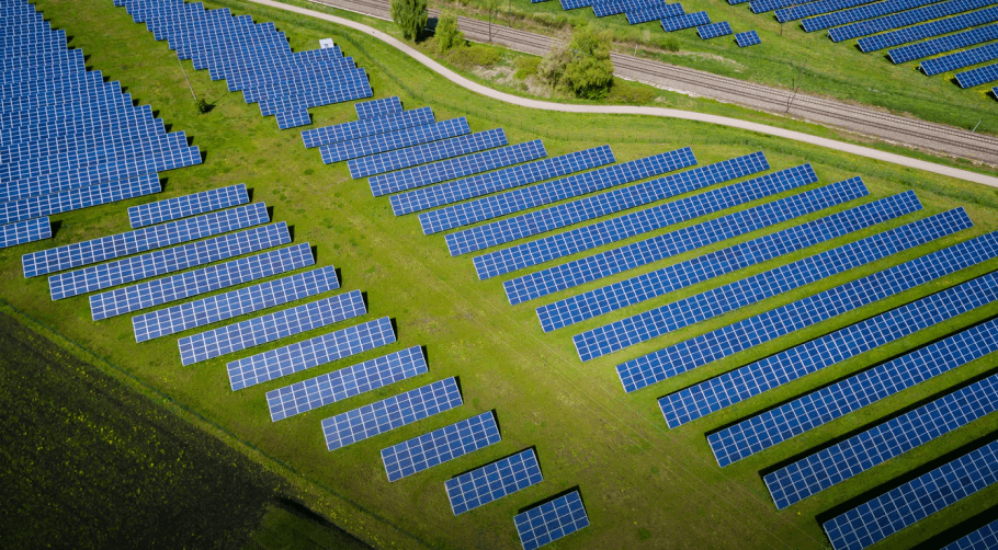 Solar panels on green gras showing how the business of solytic works